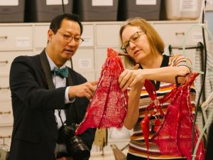 Jodi Jacyk shows President Ono a set of wings being repaired in Theatre & Film's Costume Shop.