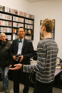 Professor Santa Ono, President of UBC pays a visit to Theatre & Film's Visual Resource Centre with Stephen Heatley and Dmitri Lennikov.